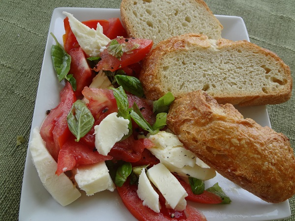 Homemade bruschetta and fresh mozzarella with roasted garlic loaf slices