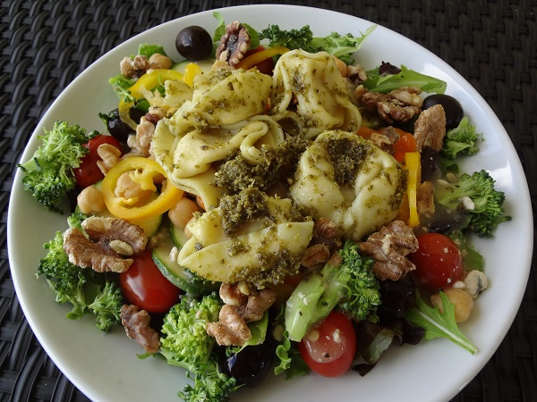 Pesto Tortellini Salad on Greens with Toasted Walnuts