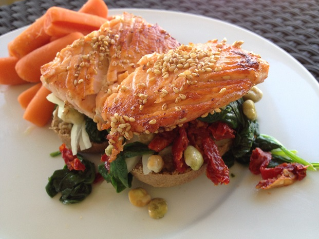 Honey Sesame Salmon Sandwich with Wasabi Peas, Sauteed Spinach, and Sun-Dried Tomatoes and Boiled Baby Carrots